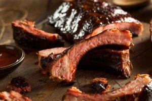 BBQ ribs on a wooden plate